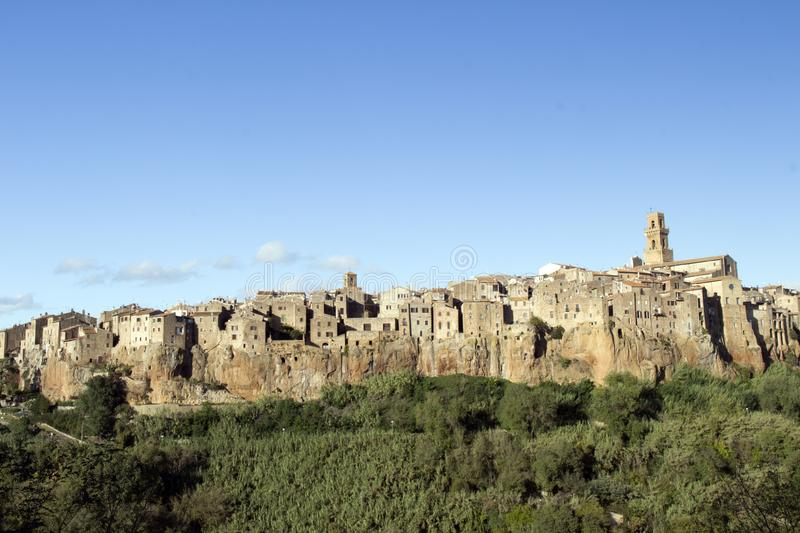 Pitigliano, one of the best town in Tuscany, Italy. Panoramic view of the tuff hill in Etruscan area in Maremma. Detail of Pitigliano, one of the best town in stock photos