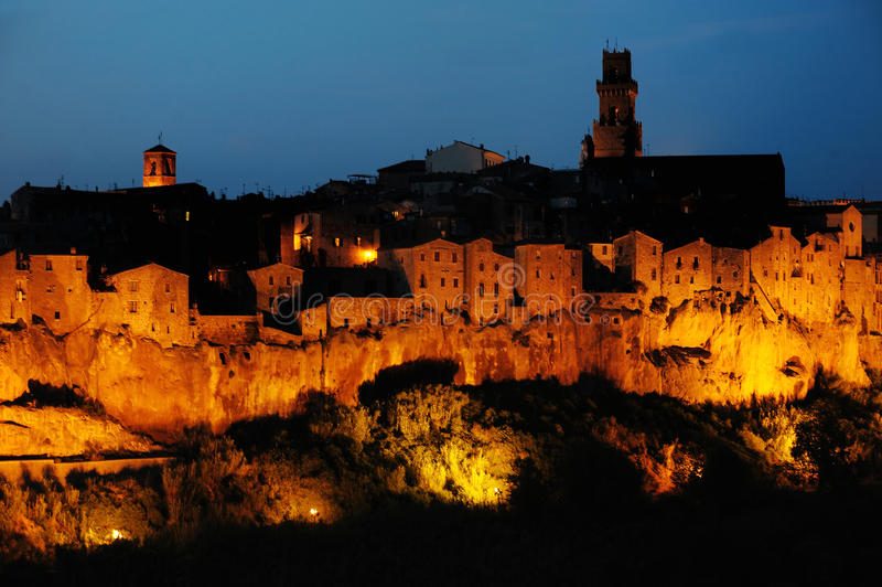 Pitigliano, Tuscany, Italy. Pitigliano town (at night), Tuscany, Italy stock photo