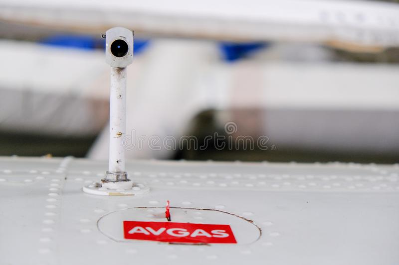 Pitot probe on top of light aircraft wing, close up detail. With fuel tank latch stock photography