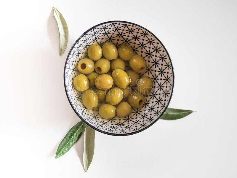 Pitted olives in a bowl on white royalty free stock photography