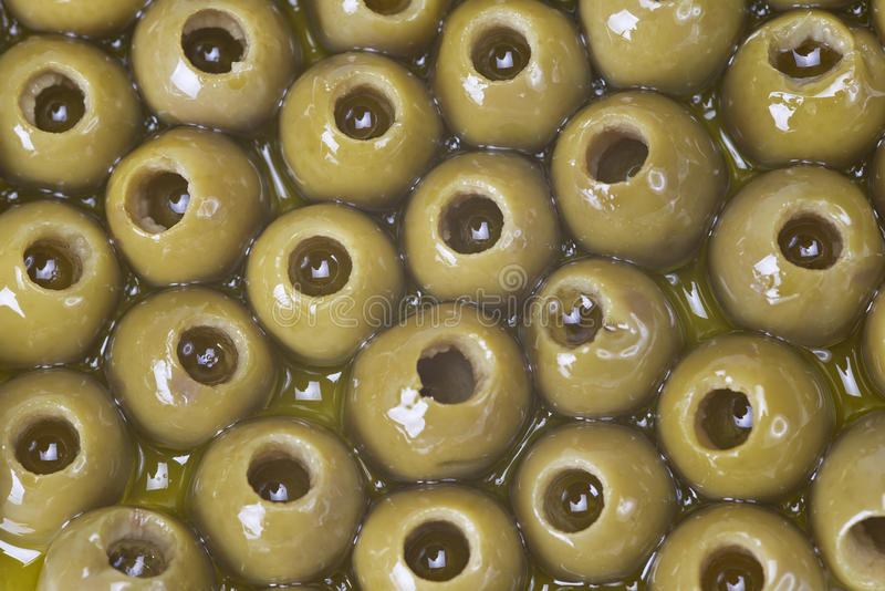 Pitted olives covered in oil stock image