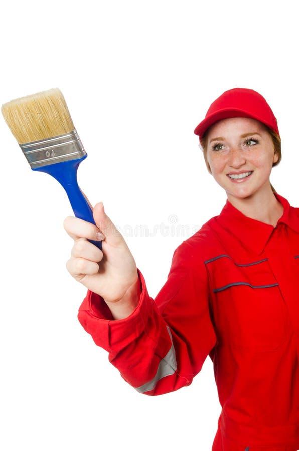 Pittore della donna in tute rosse isolate fotografia stock libera da diritti