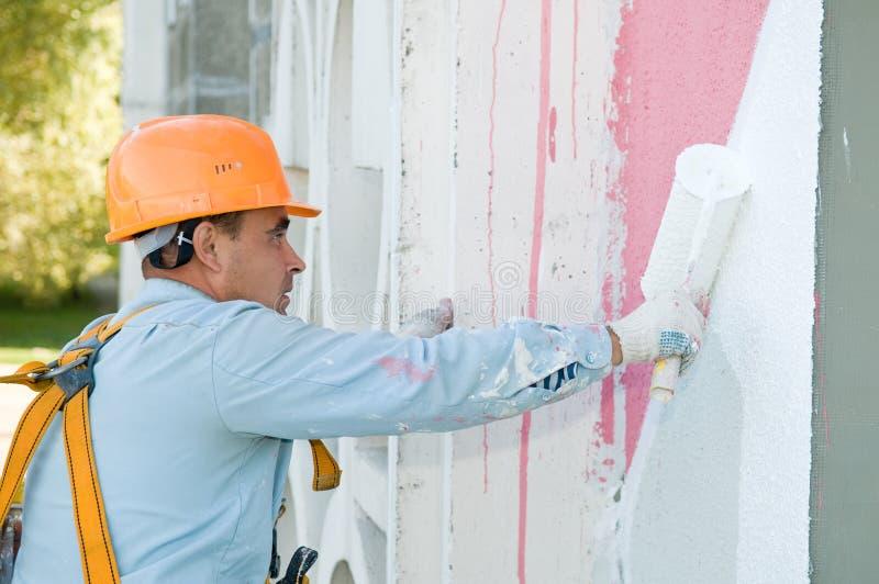 Pittore della facciata del costruttore sul lavoro fotografia stock libera da diritti