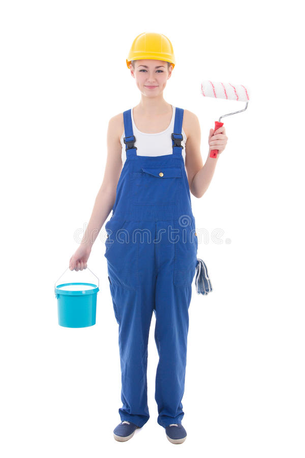 Pittore della giovane donna in tute blu con il isola degli strumenti del costruttore immagini stock libere da diritti
