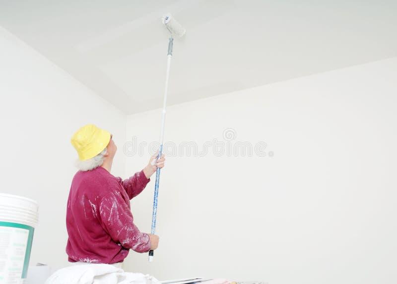 Pittore lavorante fotografie stock