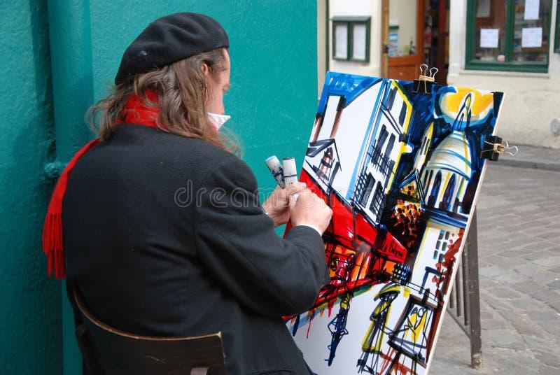 Pittore pubblico sulla collina di Montmartre a Parigi fotografia stock