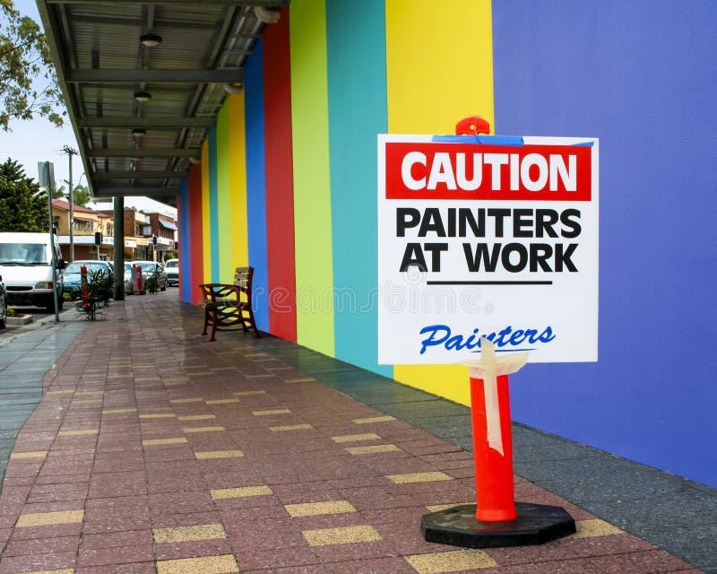 Pittori di segno di cautela sul lavoro fotografia stock