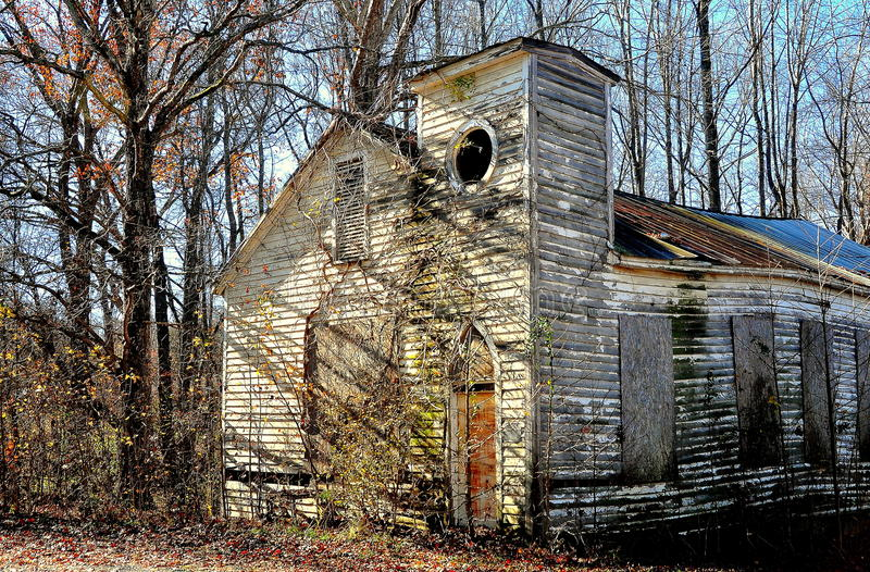 Pittsboro, NC: Old Bynum Church Ruins. Pittsboro, North Carolina - December 7, 2016: Delapidated ruins of an abandonned wooden church on Route 15-501 near Bynum royalty free stock photography
