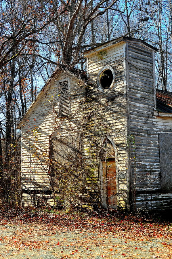 Pittsboro, NC: Old Bynum Church Ruins. Pittsboro, North Carolina - December 7, 2016: Delapidated ruins of an abandonned wooden church on Route 15-501 near Bynum royalty free stock images