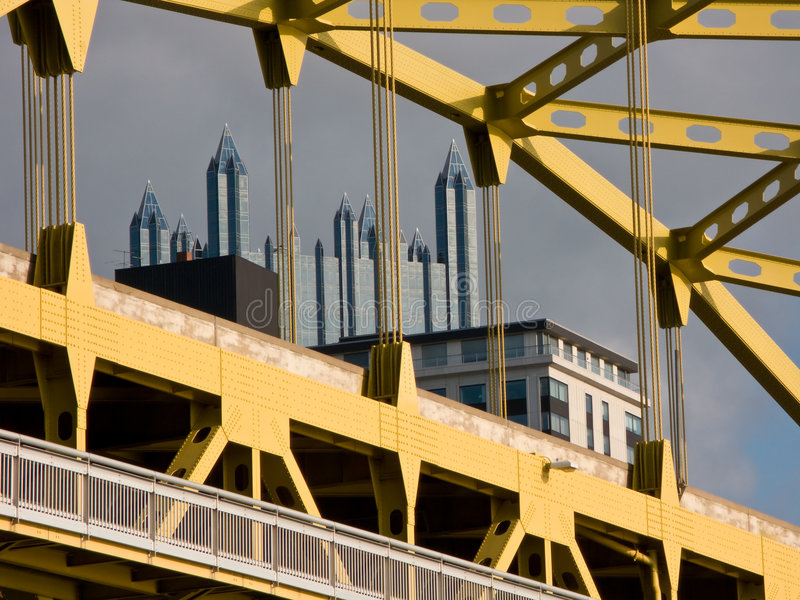 Pittsburgh, the city of steel. A view of Pittsburgh, the city of steel, and PPG Place through one of its striking yellow bridges stock images