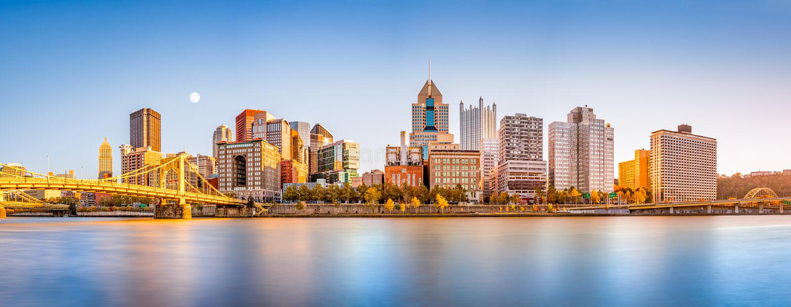 Pittsburgh downtown skyline. Long exposure of Pittsburgh downtown skyline and Roberto Clemente bridge, on a sunny afternoon, as viewed from North Shore stock images