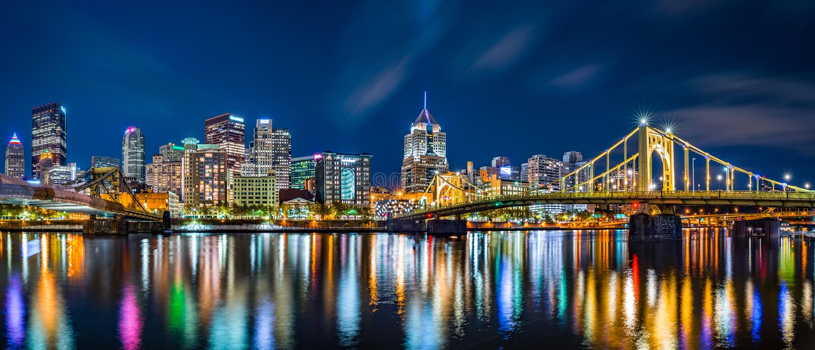 Pittsburgh downtown skyline panorama. By night viewed from Allegheny Landing, between Roberto Clemente and Andy Warhol bridges royalty free stock photo