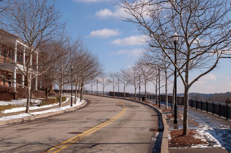 Pittsburgh, Pennsylvania, USA 02/21/2019 a bare tree lined road in winter in the Summerset neighborhood stock photo