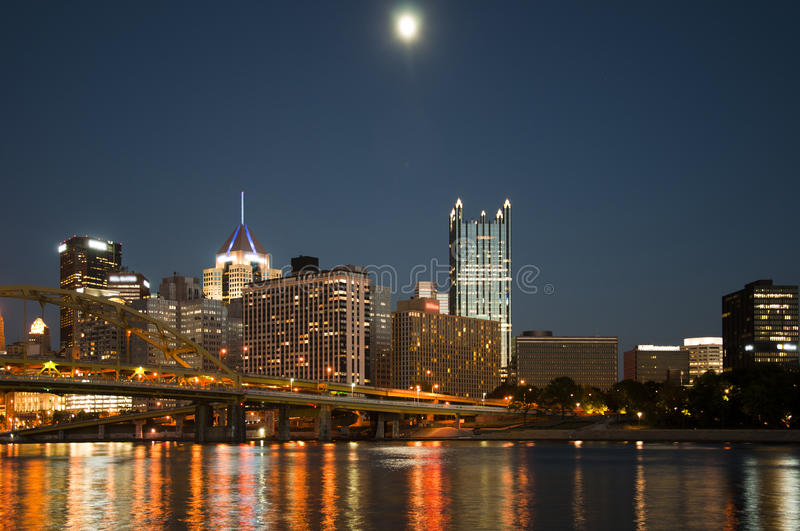 Pittsburgh usa. Pittsburgh city in the dusk with the moon in the background royalty free stock image
