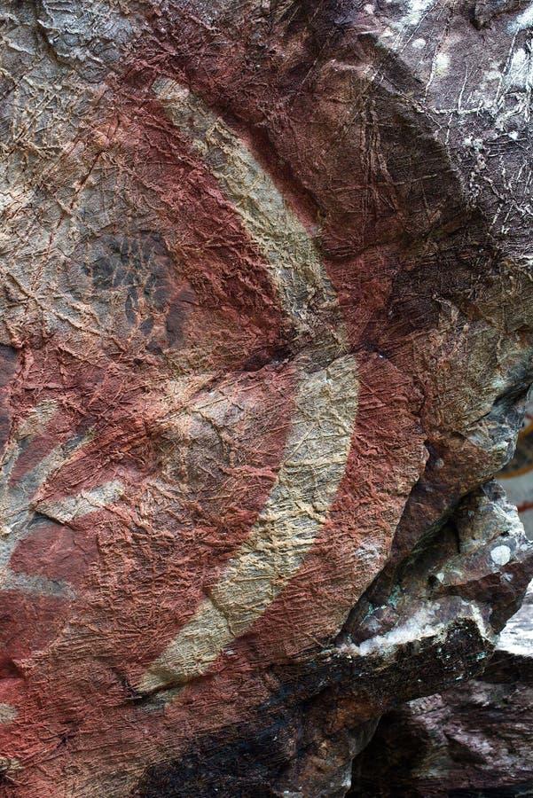 Pittura aborigena della roccia, boomerang fotografia stock libera da diritti