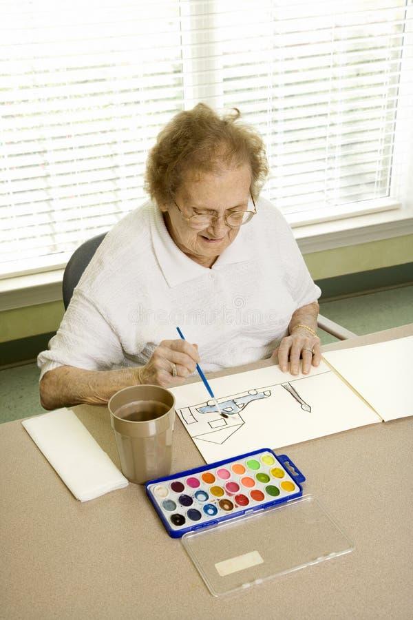 Pittura anziana della donna. immagini stock
