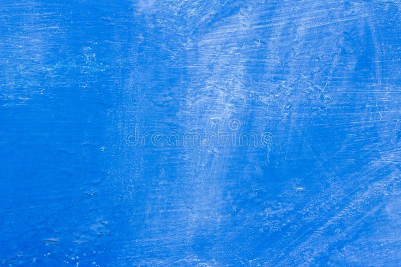 pittura blu di struttura del fondo con le macchie e schioccare in alcuni posti fotografia stock