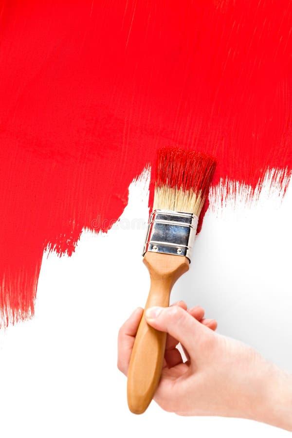 Pittura con l'inchiostro ed il pennello rossi immagini stock