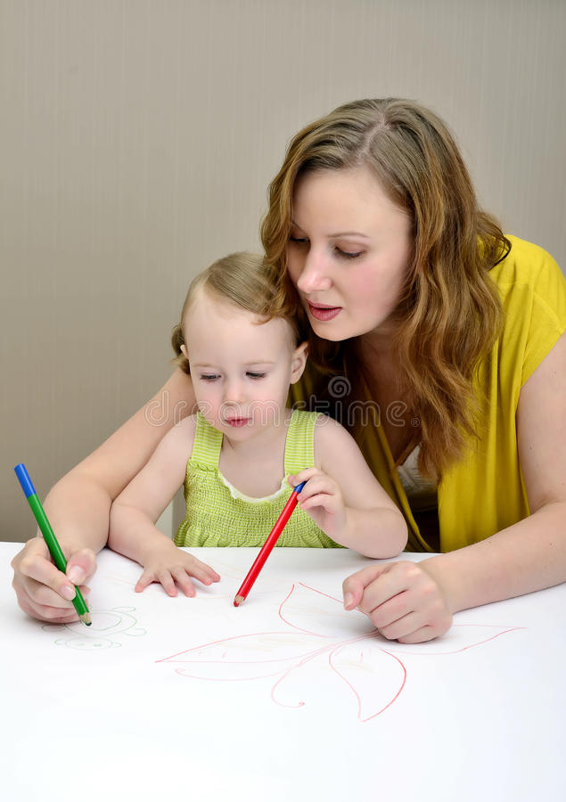 Pittura del bambino e della madre immagine stock