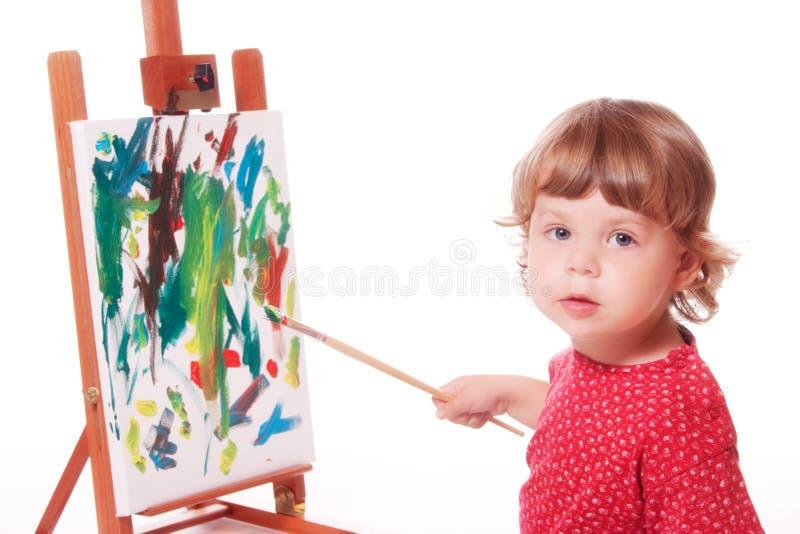 Pittura del bambino sul supporto fotografia stock