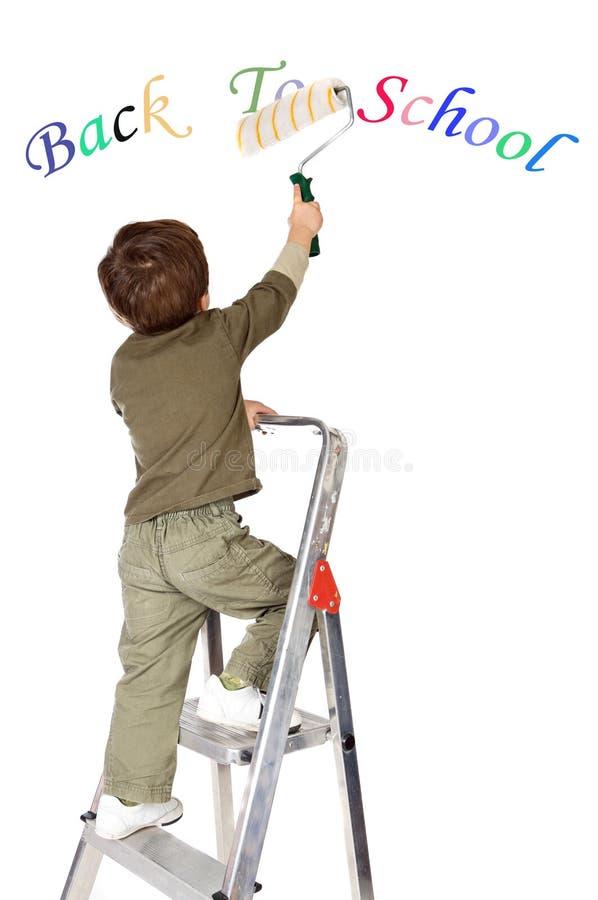 Pittura del ragazzo di nuovo al banco fotografia stock libera da diritti