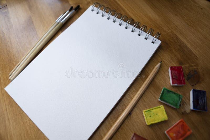 Pittura dell'acquerello in taccuino immagine stock