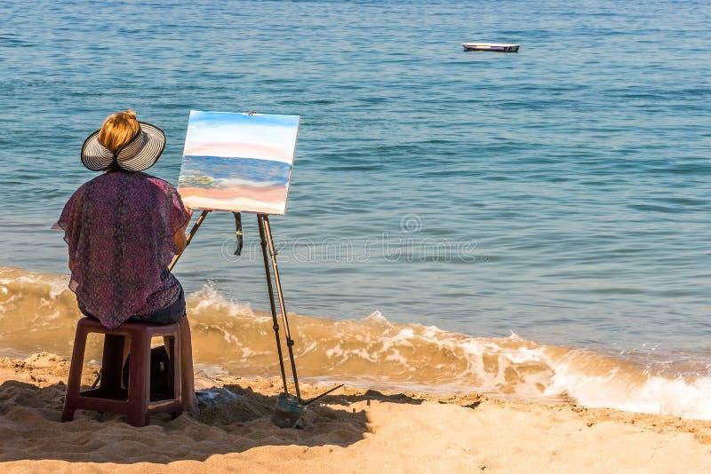 Pittura dell'artista alla spiaggia di Los Muertos, Puerto Vallarta, Messico fotografia stock