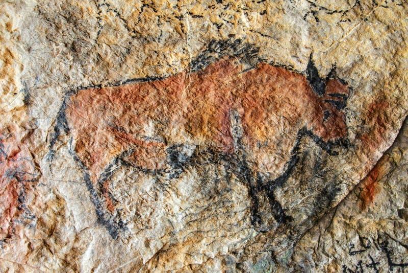 Pittura della caverna nello stile preistorico immagine stock