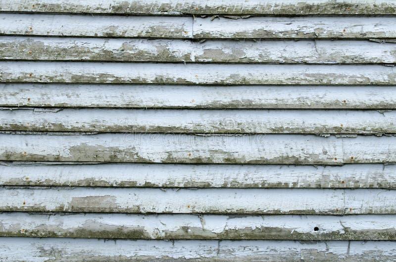 Pittura della sbucciatura di struttura dal lato della struttura edile immagini stock
