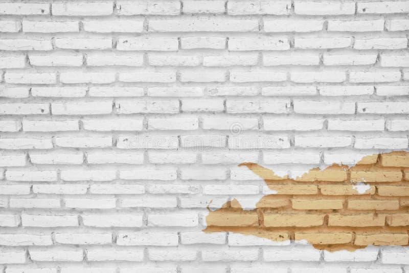 Pittura della sbucciatura sul fondo di struttura del muro di mattoni fotografia stock libera da diritti