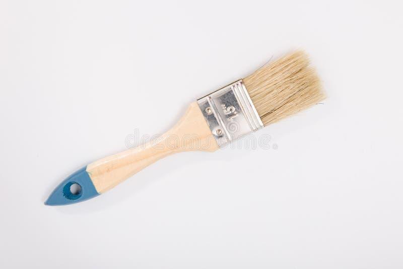 Pittura della spazzola piccola su un fondo bianco isolato fotografie stock