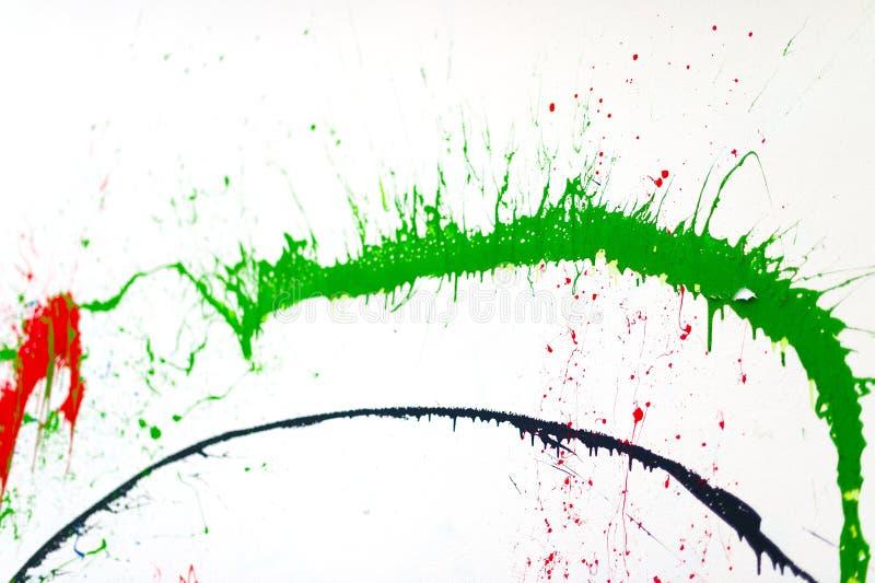 Pittura di spruzzo su una parete bianca fotografia stock libera da diritti
