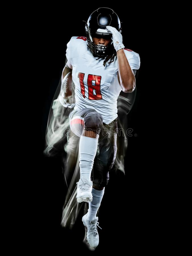 Pittura nera della luce del fondo isolata uomo del giocatore di football americano fotografia stock libera da diritti