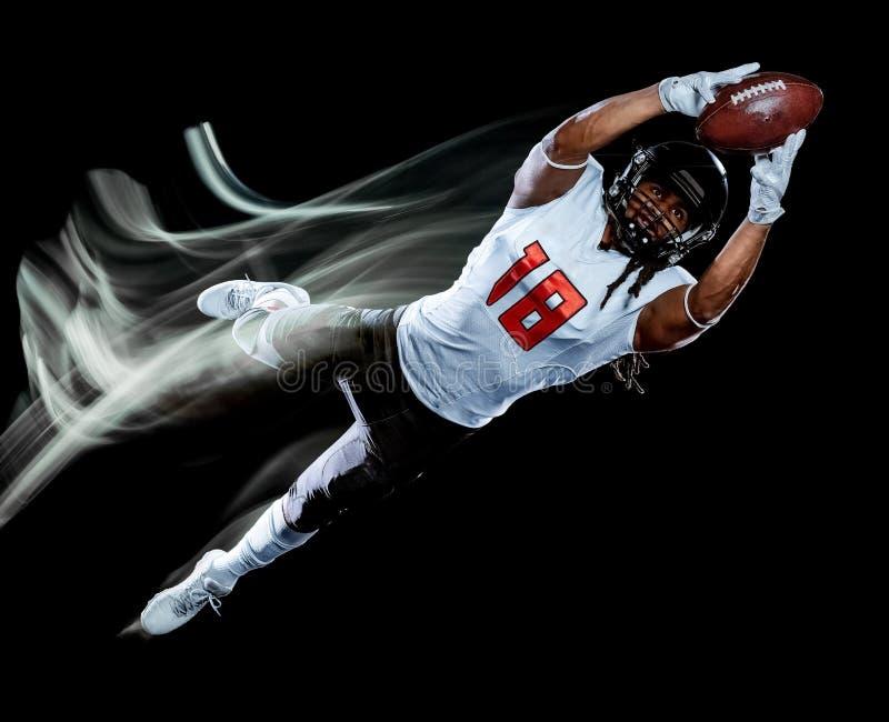 Pittura nera della luce del fondo isolata uomo del giocatore di football americano immagini stock