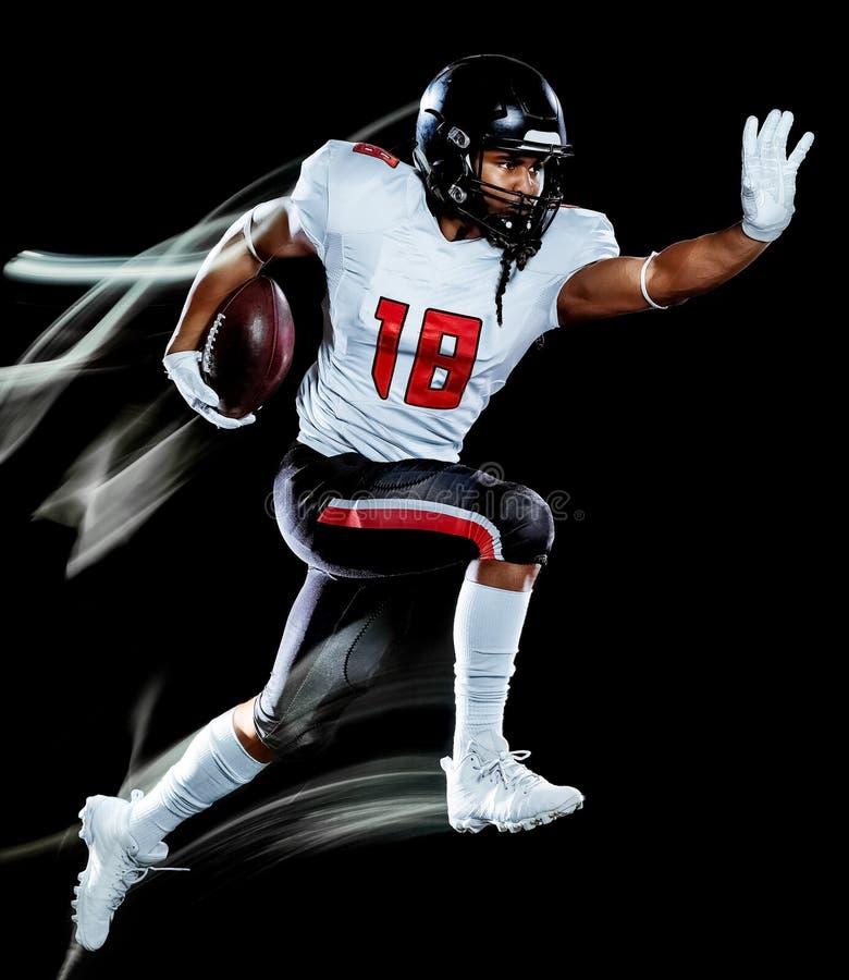 Pittura nera della luce del fondo isolata uomo del giocatore di football americano fotografie stock