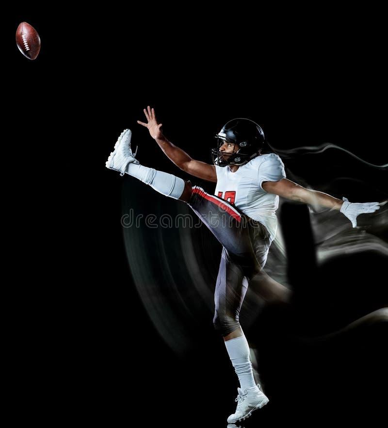 Pittura nera della luce del fondo isolata uomo del giocatore di football americano immagini stock libere da diritti