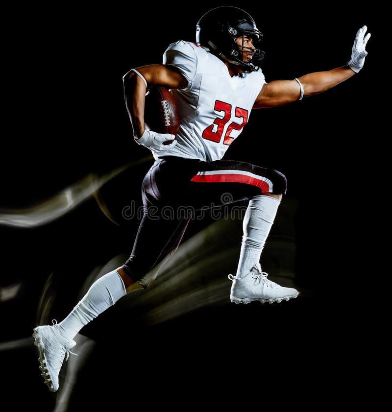 Pittura nera della luce del fondo isolata uomo del giocatore di football americano fotografia stock