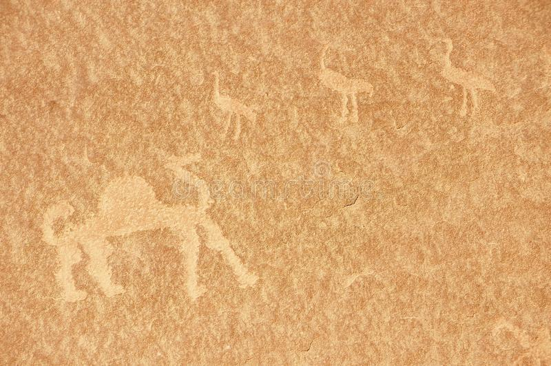 Pittura preistorica della roccia nel deserto Wadi Rum, Giordania della sabbia fotografie stock