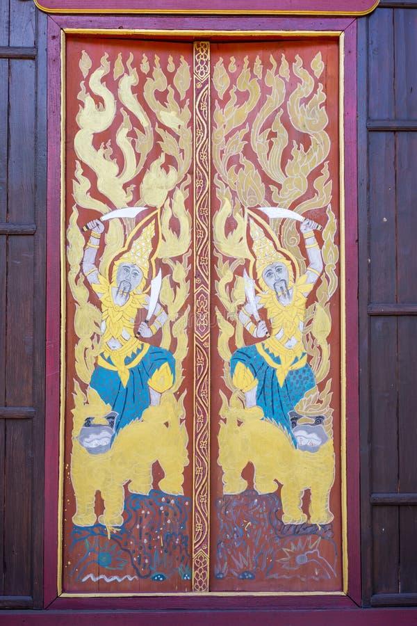 Pittura tailandese tradizionale di stile sulla parete di legno fotografia stock