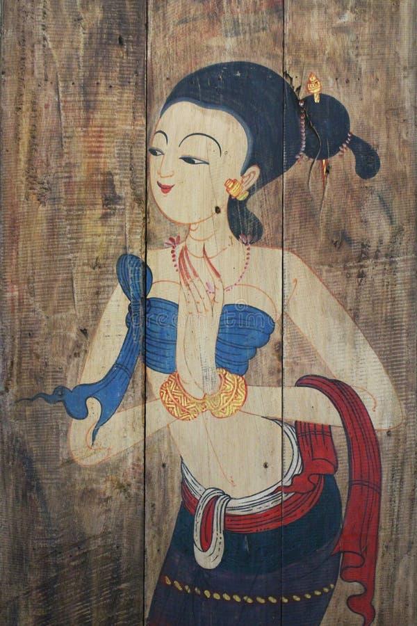 Pittura tradizionale antica della donna con il costume sugli ambiti di provenienza marroni di legno, stile tailandese che sta fem fotografie stock libere da diritti