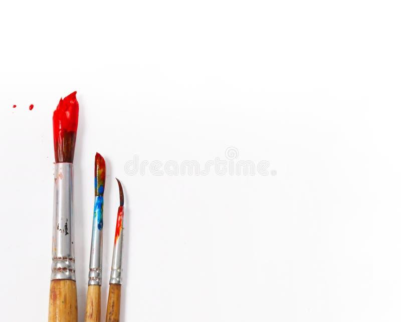 Pitture con la spazzola fotografie stock