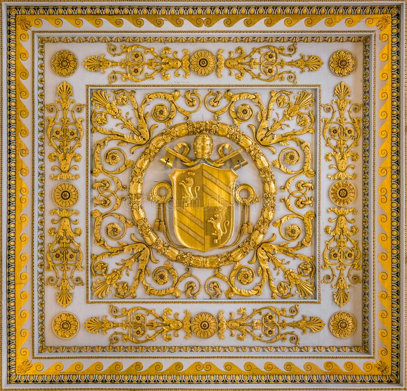 Pius IX coat of arms from the ceiling of the Basilica of Saint Paul Outside the Walls, in Rome. The Papal Basilica of St. Paul Outside the Walls, commonly known stock photography
