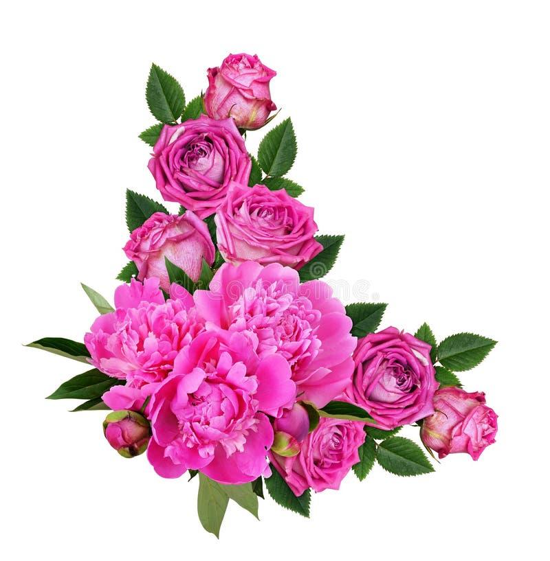 Pivoines roses et fleurs roses dans un arrangement floral faisant le coin photo stock