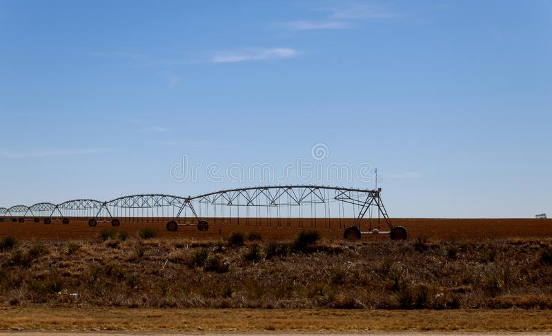 Pivot irrigation system at farmland in the Arizona Desert royalty free stock image