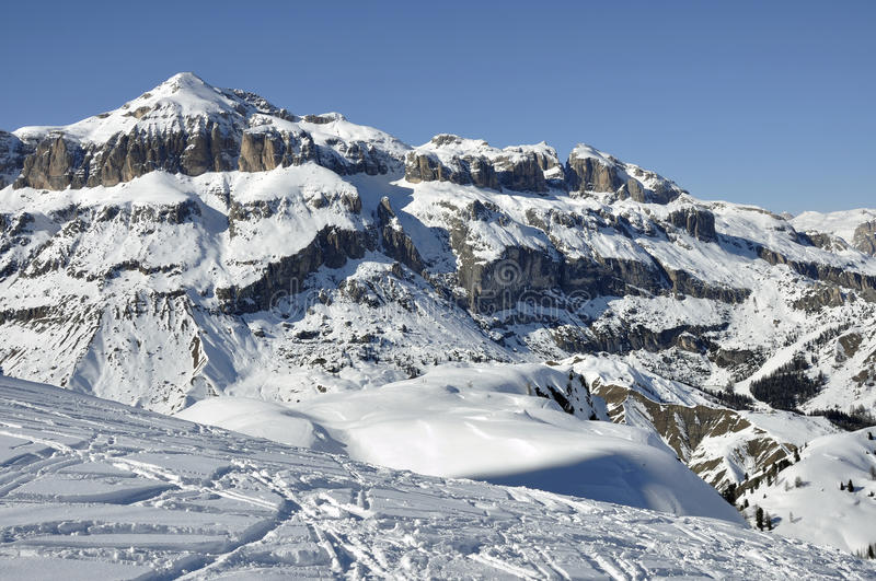 Piz boe' east side, dolomites. View of famous group in dolomite with steep cliffs and snowy slopes, shot in bright winter light from the east side of the royalty free stock image