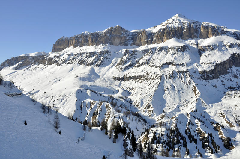 Piz boe' group, dolomites. View of famous group in dolomite with steep cliffs and snowy slopes, shot in bright winter light from the east side of the mountain royalty free stock image