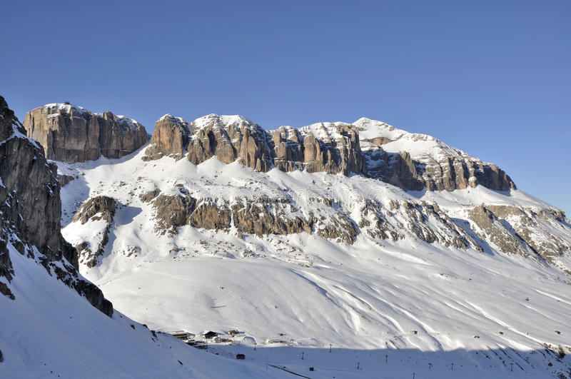 Piz boe' high crags, dolomites. View of famous group in dolomite with steep cliffs and snowy slopes, shot in bright winter light from the east side of the royalty free stock image