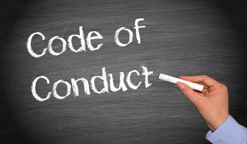 Pizarra del código de conducta con la mano femenina fotografía de archivo