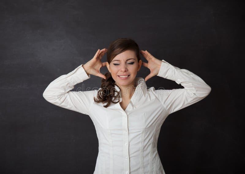 Pizarra del dolor de cabeza de la mujer fotografía de archivo
