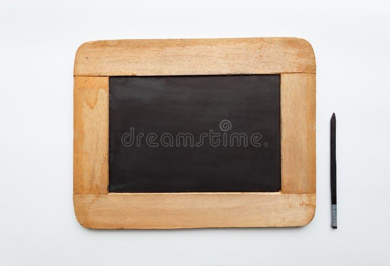 Pizarra en blanco vieja y lápiz del marco de madera de la vendimia foto de archivo libre de regalías